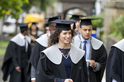 Students dressed in graduation gowns