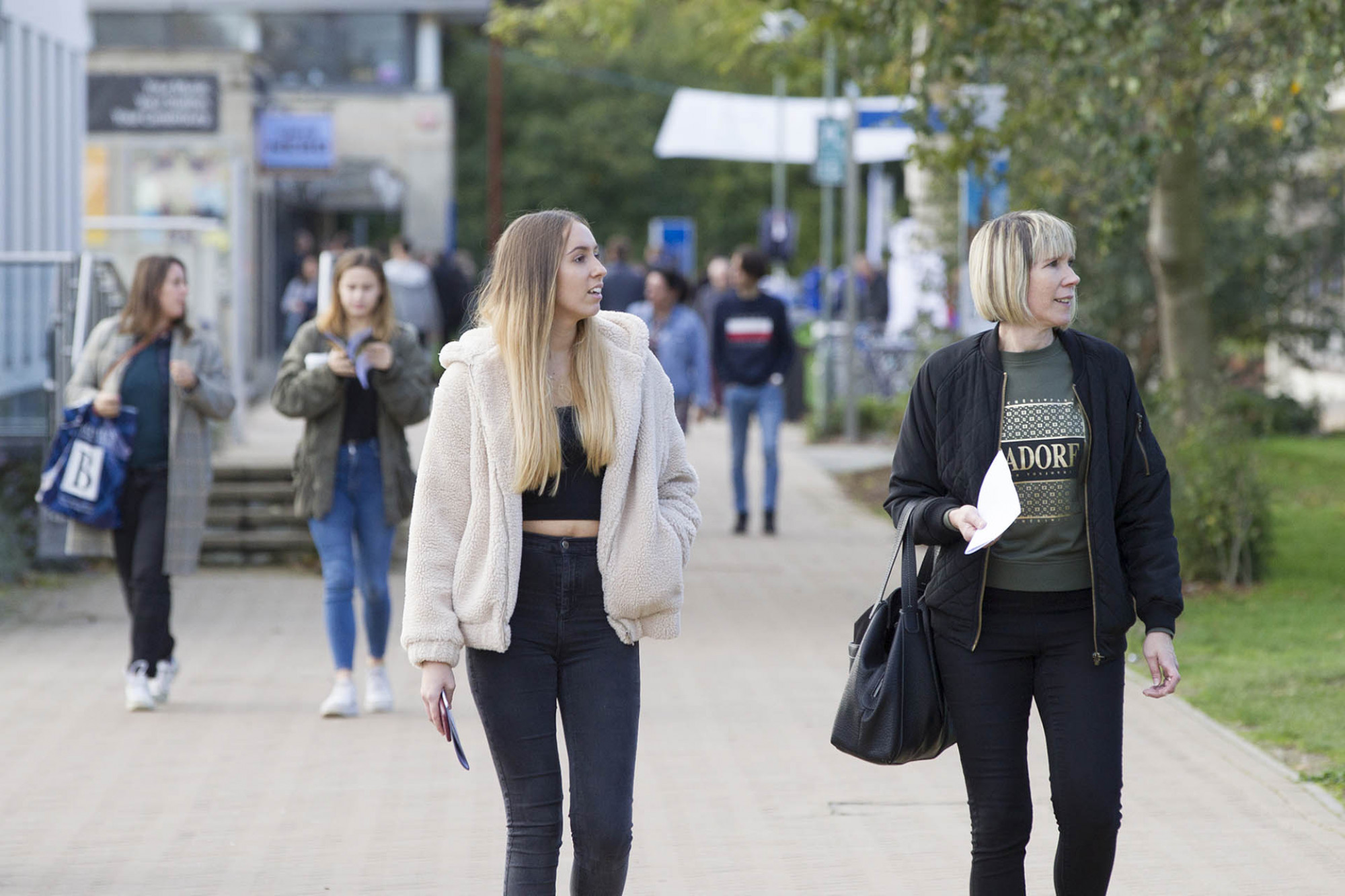 Mother and daughter walking around campus