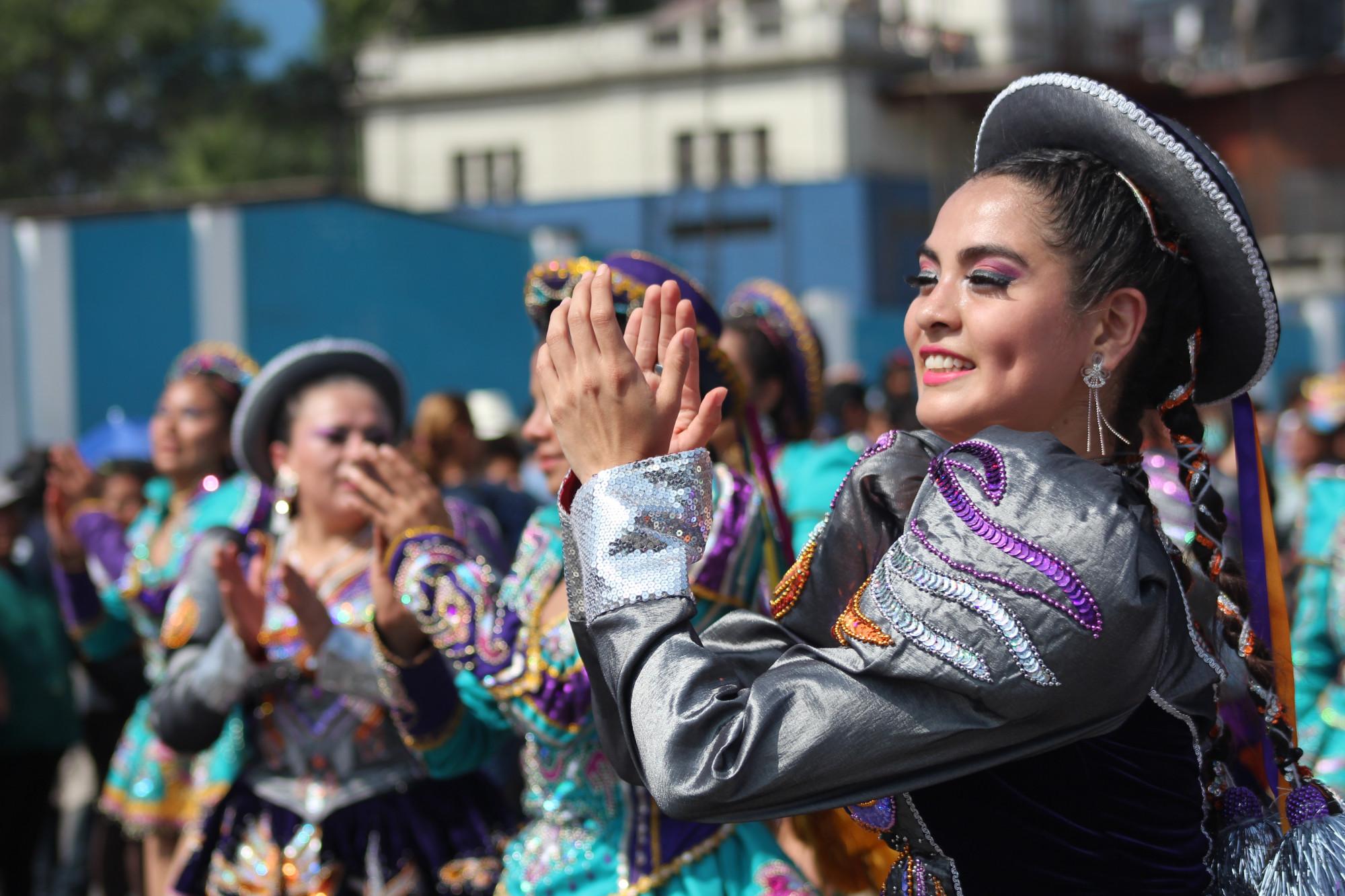 Peruvian women clapping during local festivities
