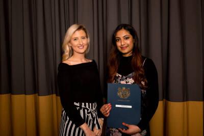 student receiving award at Go Abroad Awards