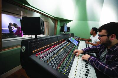 two students using the Neve Genesys console.