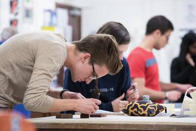 Young student in an architecture workshop