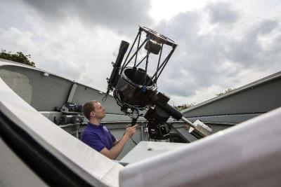 man operating beacon observatory