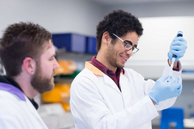 Male student using a pipette