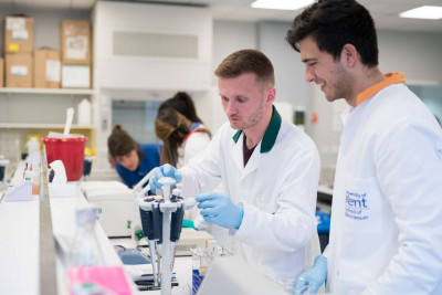 Male student working with lab equipment