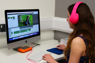 Female student editing a film