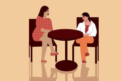 Cartoon in orange and red tones of two people sitting at a table talking.