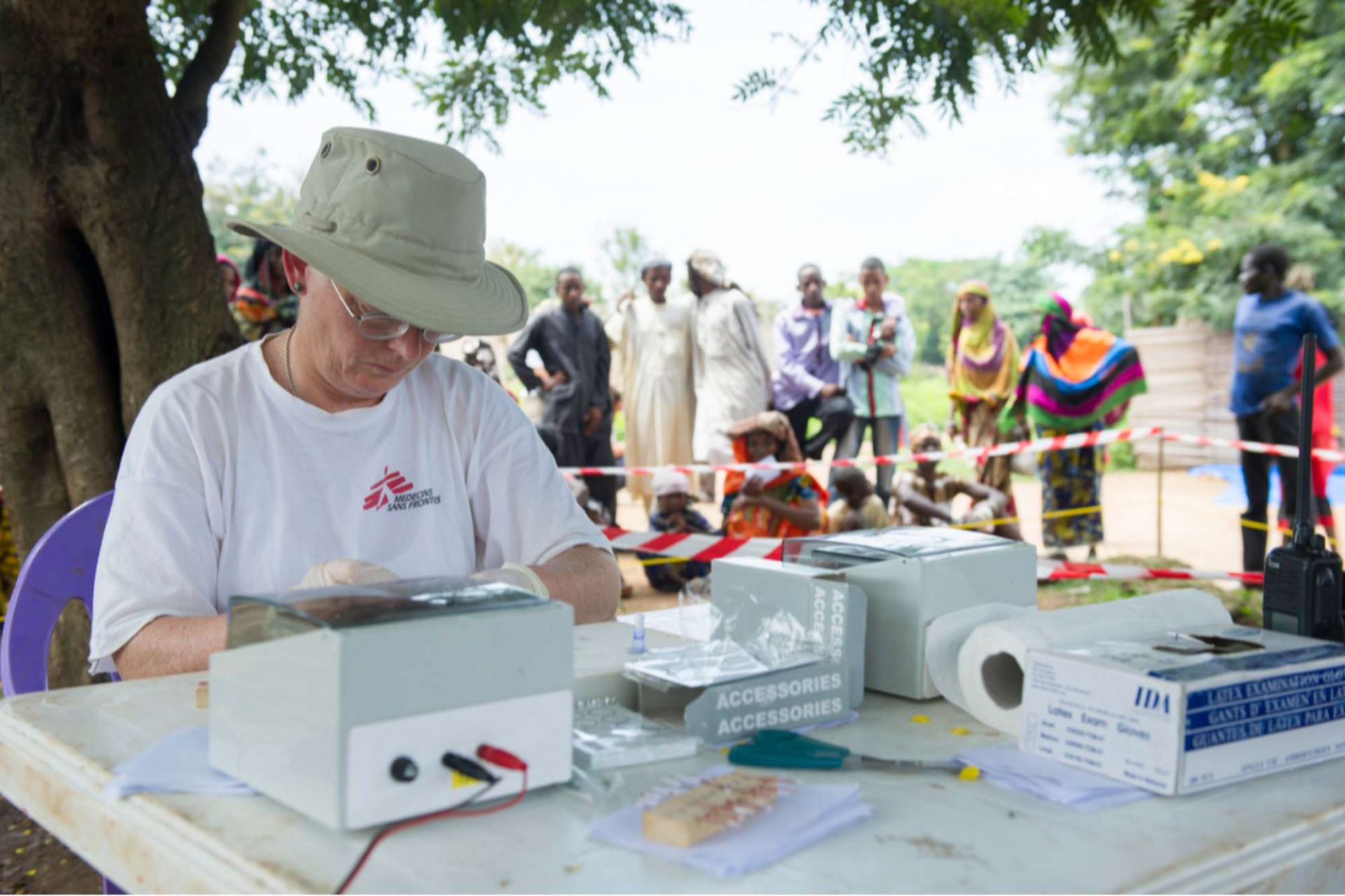 Academic working on testing in an African village