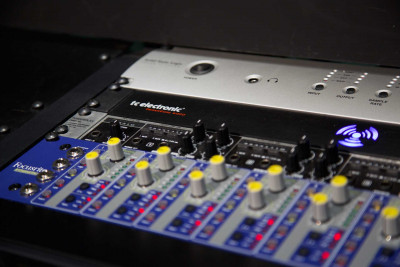 A pre-amp with rows of yellow dials and red lights.