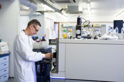 Laboratory technician using the electrospray mass spectrometer