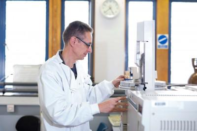 Laboratory technician using GC-MS equipment