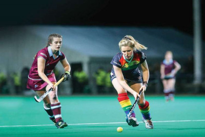 Women's hockey match, two players going for the ball