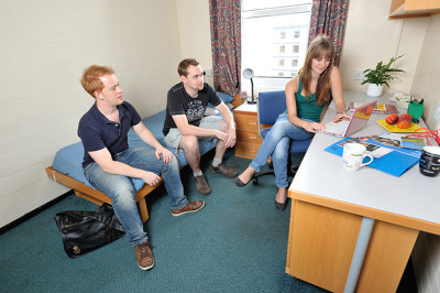 Students watching tv in a Rutherford bedroom