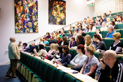 A lecture takes place in a lecture theatre.