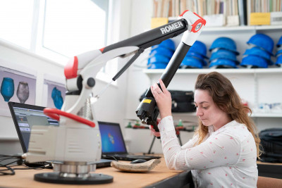 Student using a scanner to produce a 3D image of an artefact