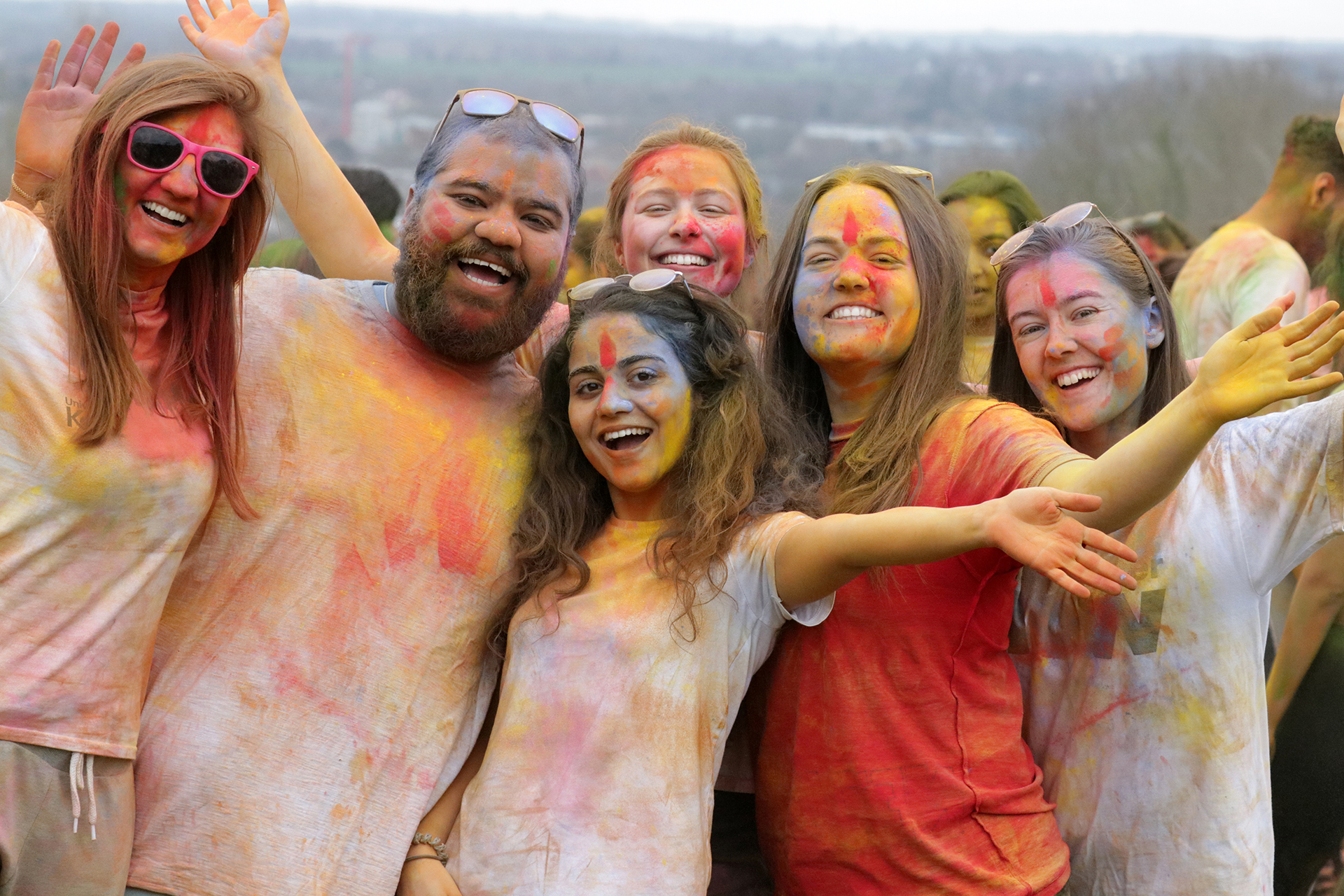 Students covered in paint to celebrate Holi Festival