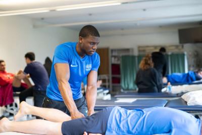 Student massaging client