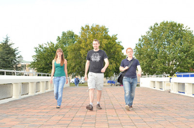 Three students walking towards Rutherford College