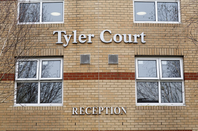 Tyler Court external wall with sign for reception