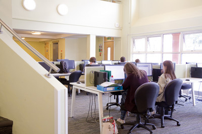 Students work in a shared study space in Tyler Court A