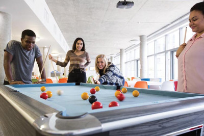 Students playing pool in Hut 8 catering outlet