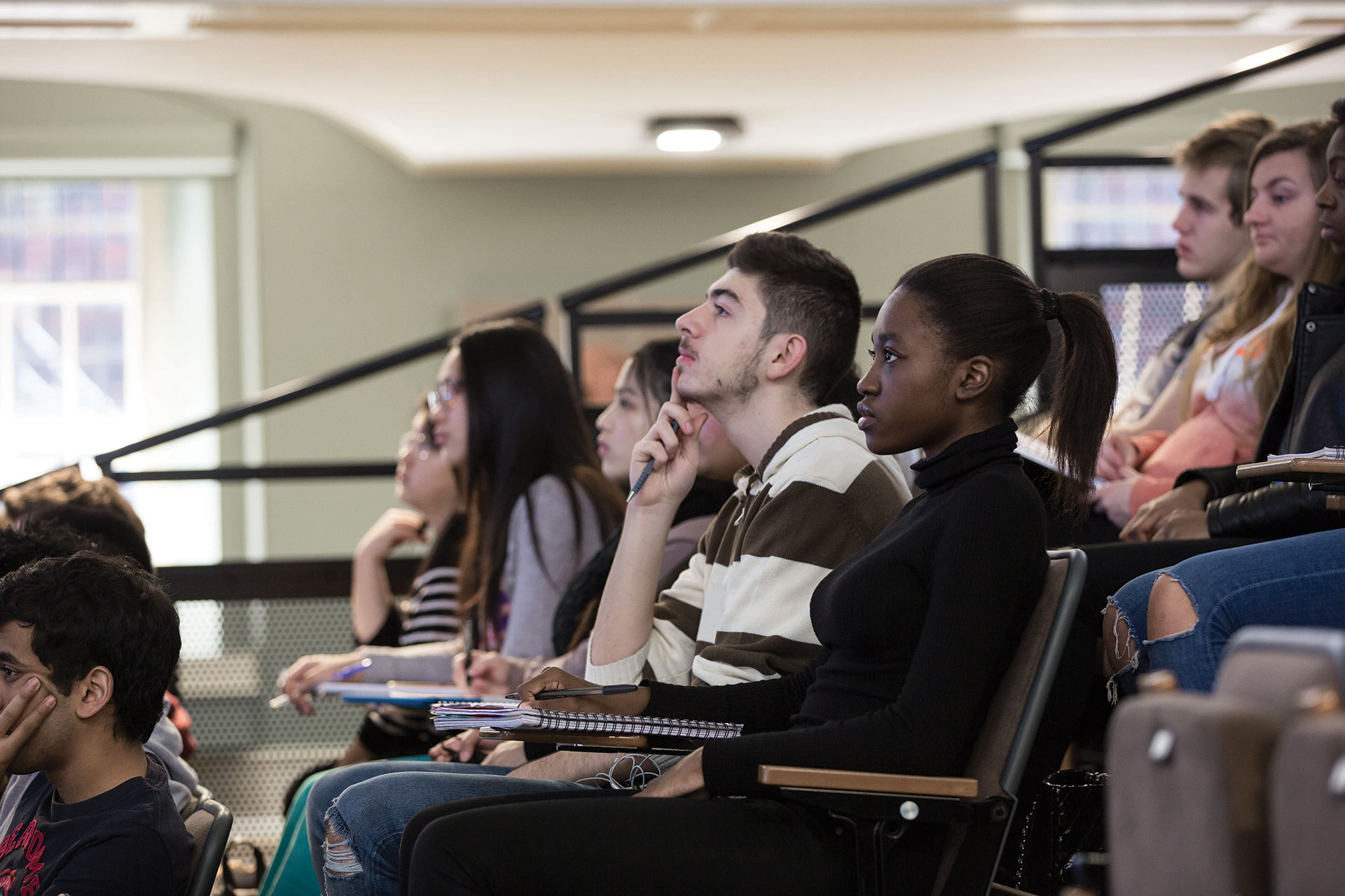 Mixed group of students in a lecture theatre