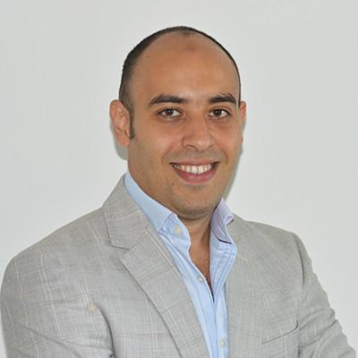 Portrait of Dr Amgad Badewi