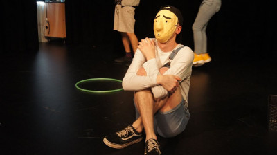 Student poses in mask