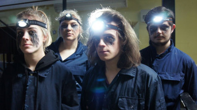 Students with headlamps and sinister make-up.