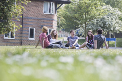 Students relaxing and chatting outside Park Wood houses