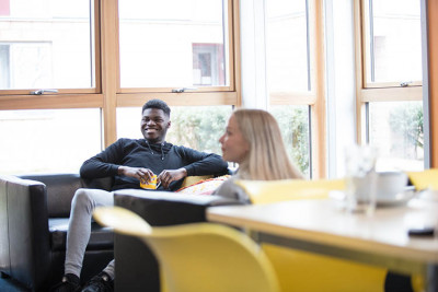 Students relax with tea in Keynes House kitchen