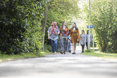 Students walking into campus from Park Wood accommodation