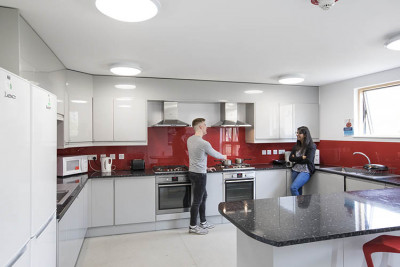 Two students chatting in a Tyler Court kitchen