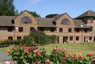 Darwin Houses exterior and rose garden